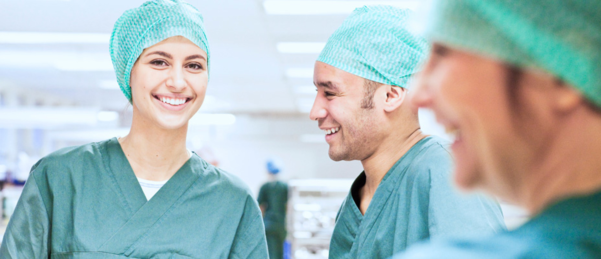 Three doctors/nurses in operation