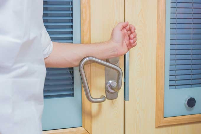 Opening a door with the arm