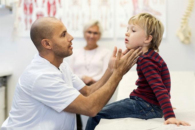 Doctor/nurse examining a child