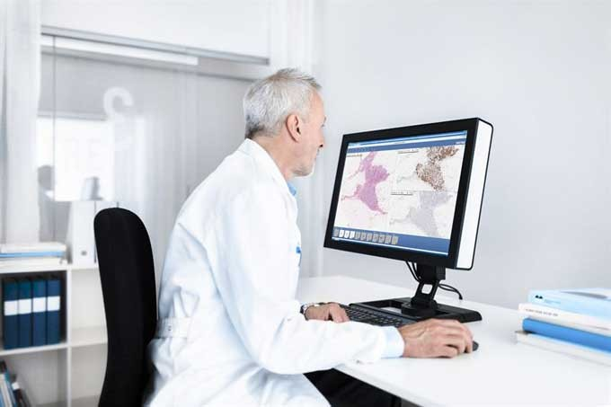 Doctor working by computer screen